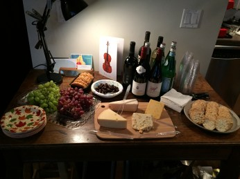 A spread of wine and cheese was on offer.