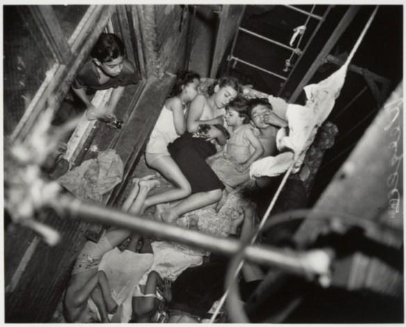 """Children on Fire Escape"" by Weegee (Arthur Fellig)"