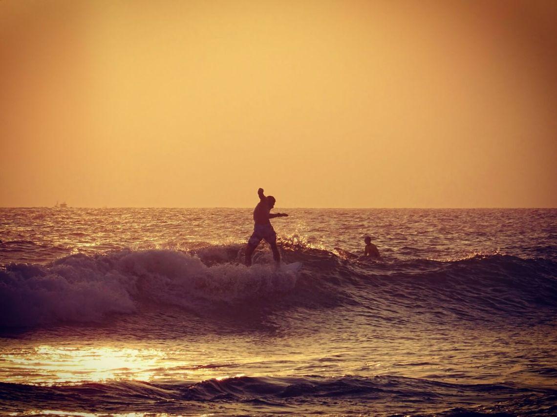 Surfer at sunset in Mirissa