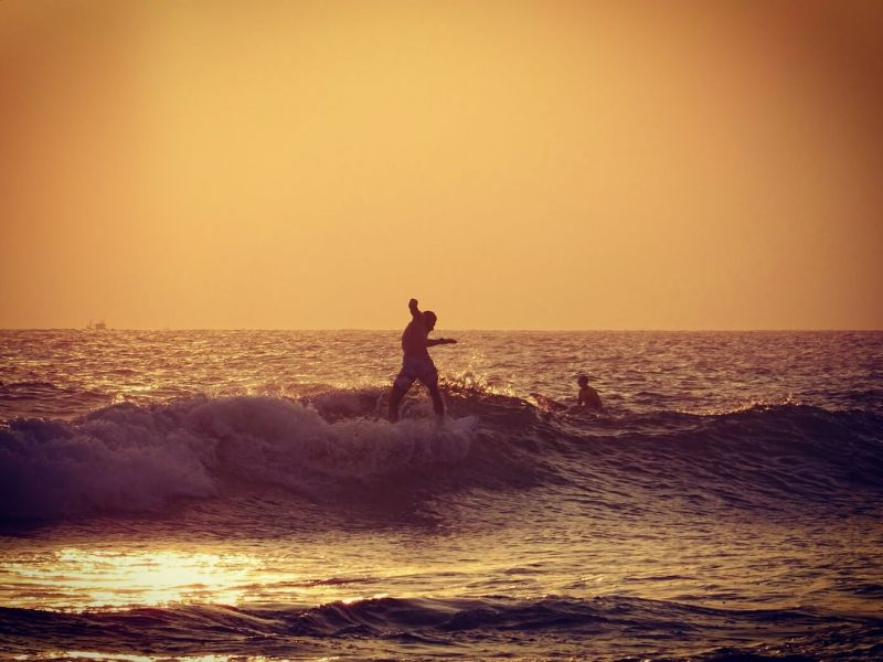 Surfer at sunset in Mirissa