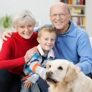 © Racorn | Dreamstime.com - Happy Little Boy With His Elderly Grandparents Photo