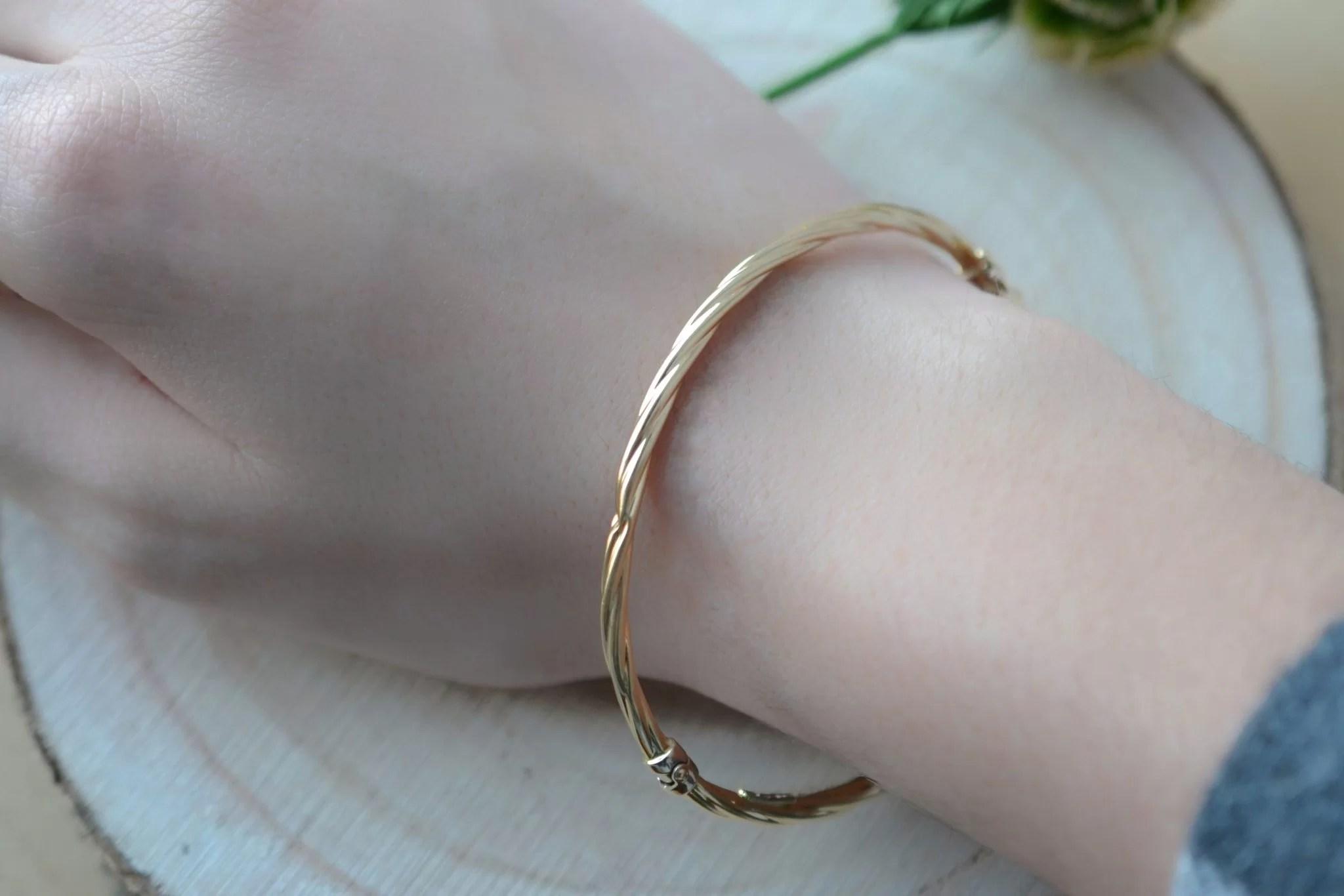 Bracelet rigide torsadé ouvrant en Or jaune - bijou de seconde main