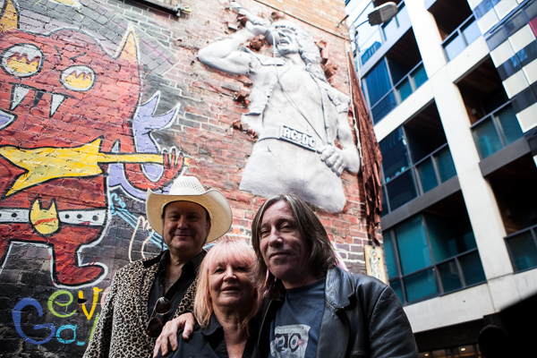 James Young, Mary Renshaw and Dave Stevens at the Bon Scott statue unveiling AC/DC lane in Melbourne where Cherry Bar is located. Photo by Ros O'Gorman
