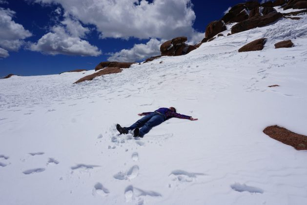 Making a snow angel atop Pikes Peak.