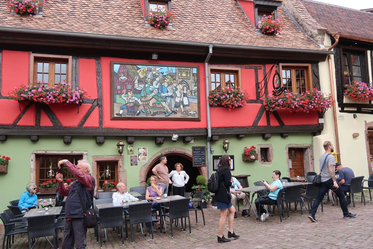 Visitors outside of a winery in France's Alsace region