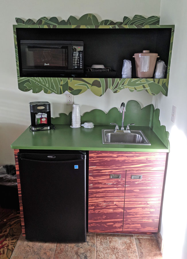 Art of Animation family suites kitchenette with mini-fridge, sink, and microwave