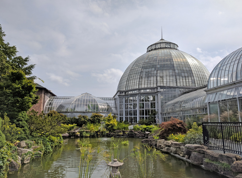 Domed conservatory with decorative pond