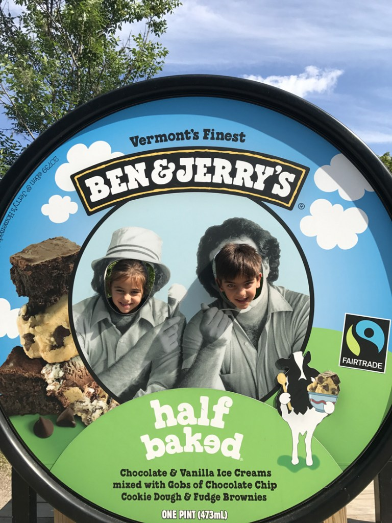 Two children posing in a giant ice cream pint lid at the Ben & Jerry's Factory