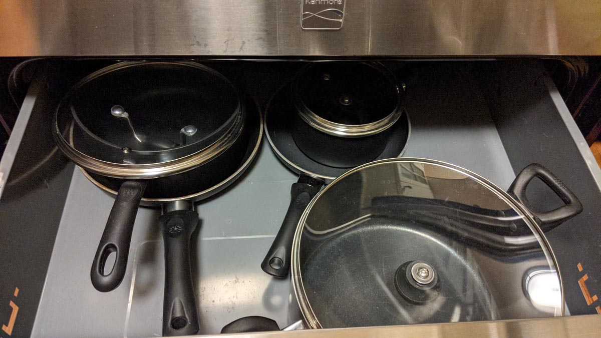 Drawer full of pots, pans, and lids