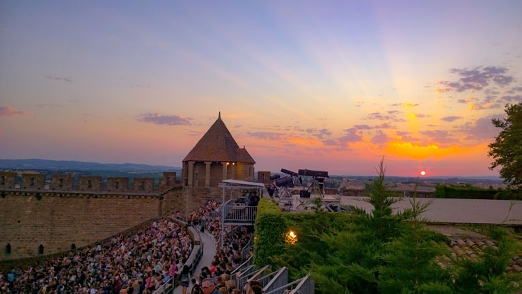 Sunset over a crowded amphitheater at the historic Citadel in Carcassonne