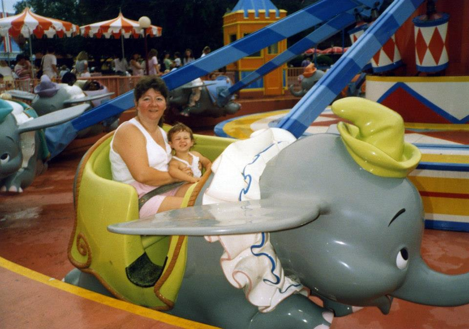 Woman and child on Dumbo at the Magic Kingdom