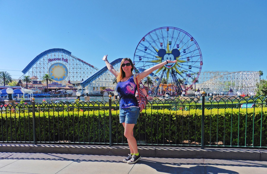 Woman posing in front of Paradise Pier at California Adventure
