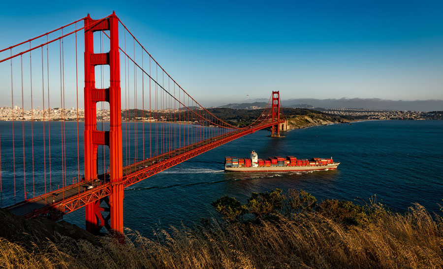 Orange towers of the Golden Gate Bridge with San Francisco in the background