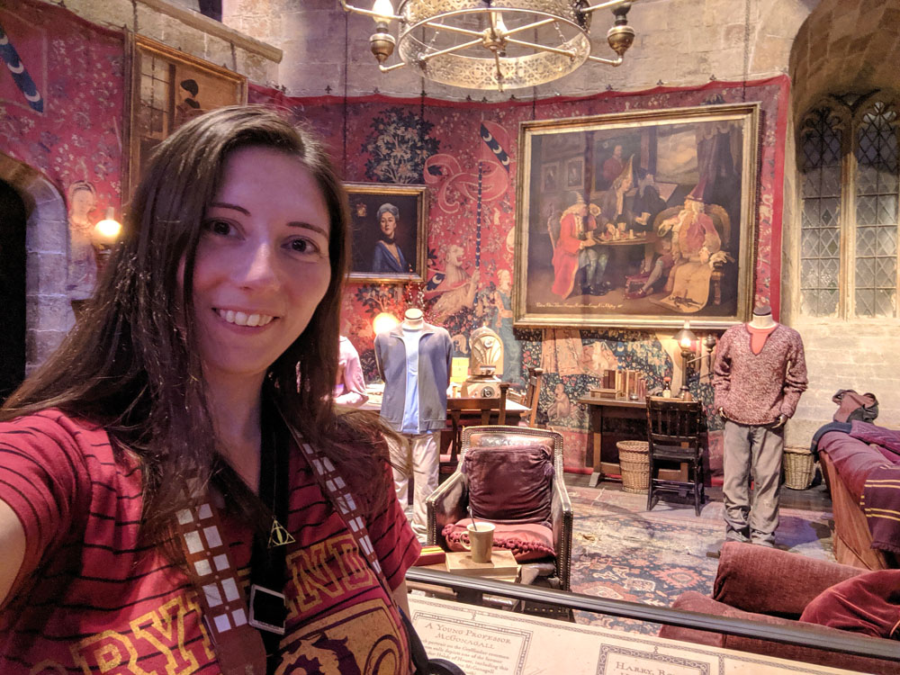 Woman posing in front of the Gryffindor Common Room set on the Harry Potter Studio Tour London