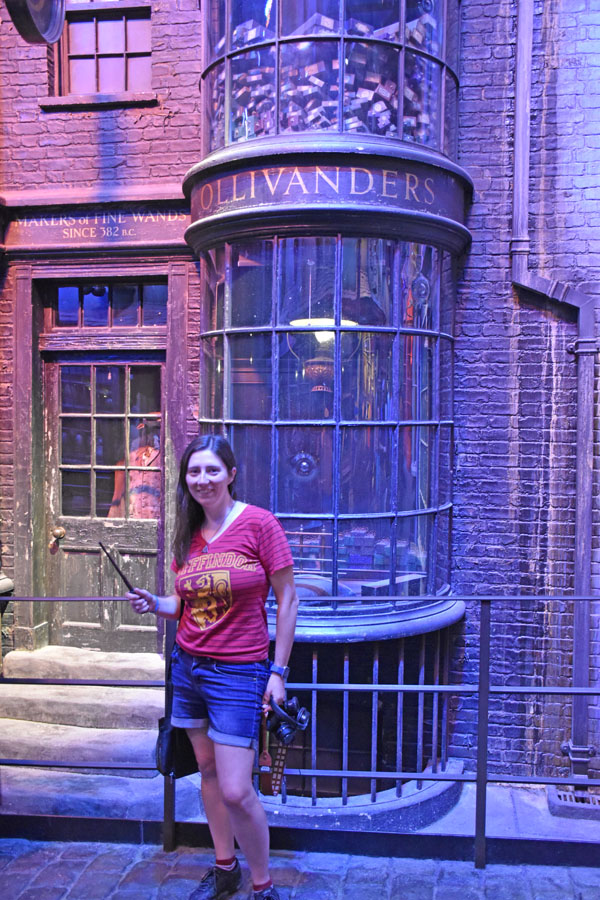 Woman posing in front of Ollivanders in Diagon Alley