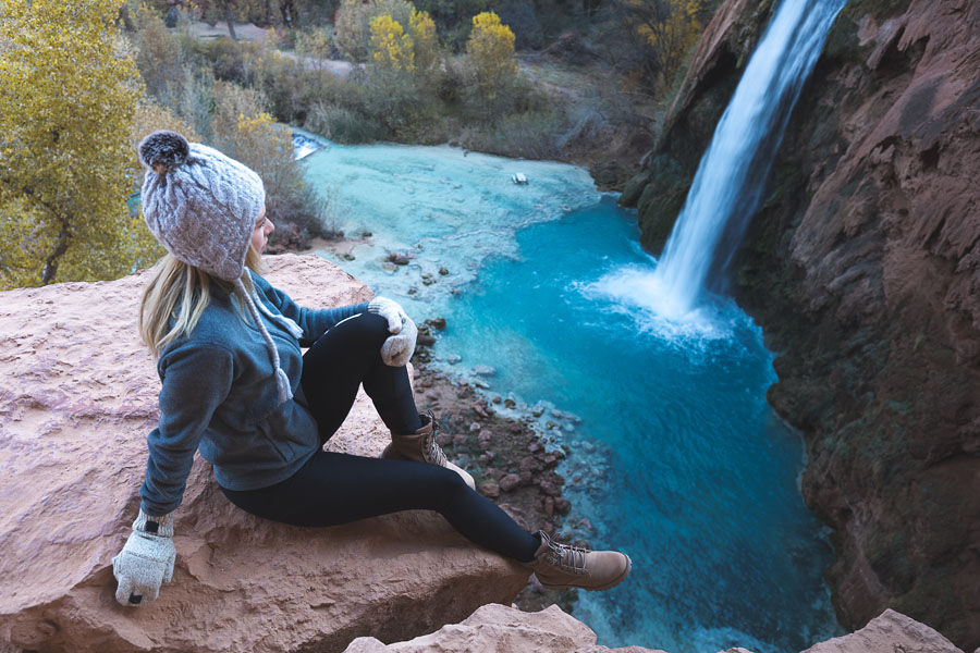 Woman posing in front of Havasu Falls in Arizona