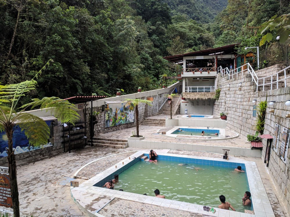 People relaxing in pools at the hot springs in Aguas Calientes, Peru