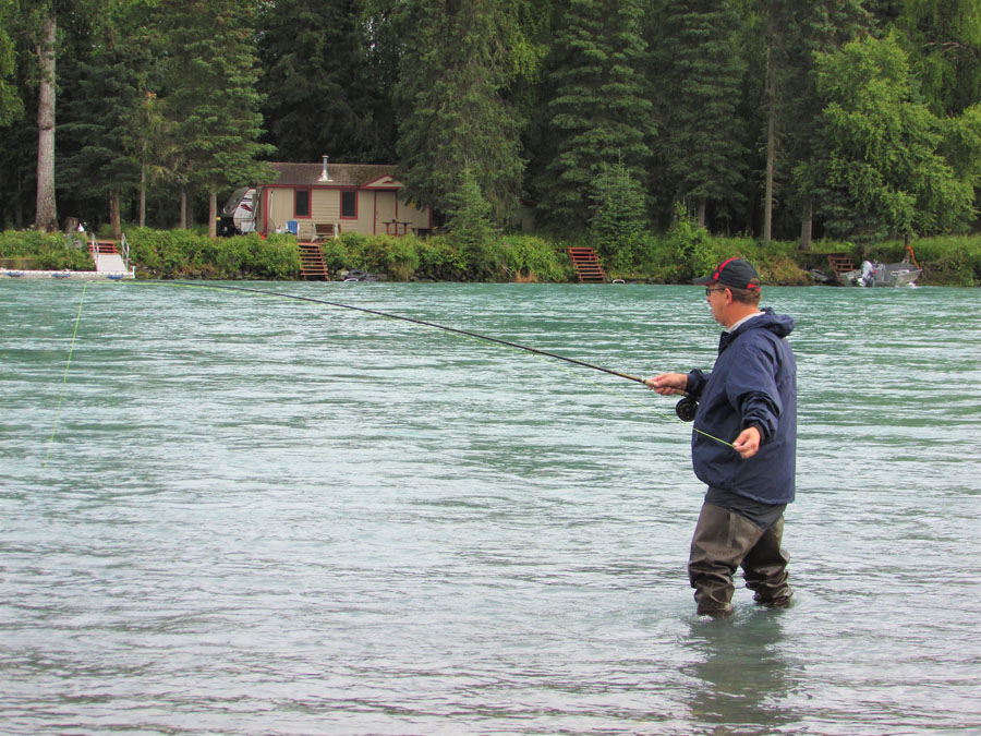 Man holding a fishing rod in the Kenai River