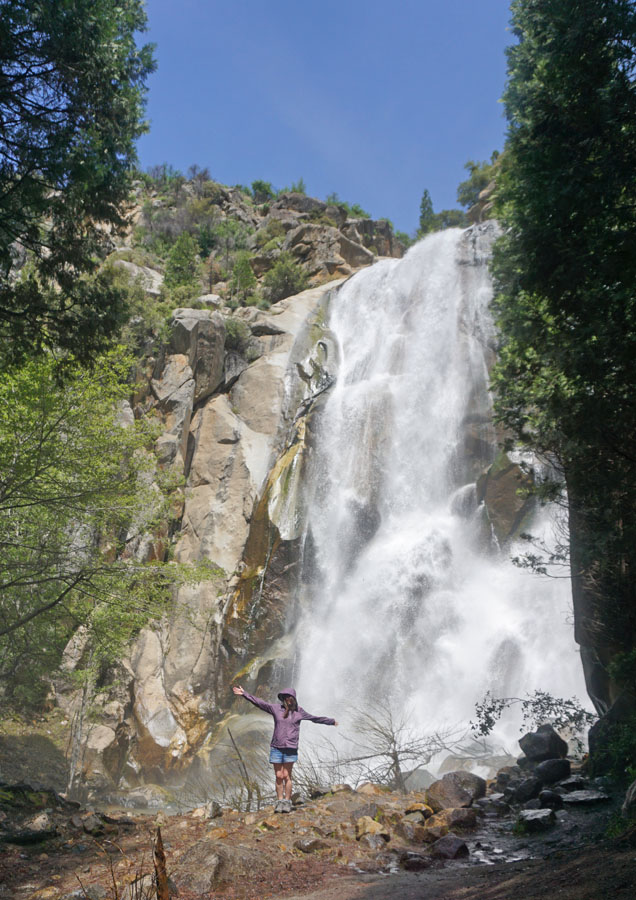 Woman standing in front of Grizzly Falls in Sequoia National Forest