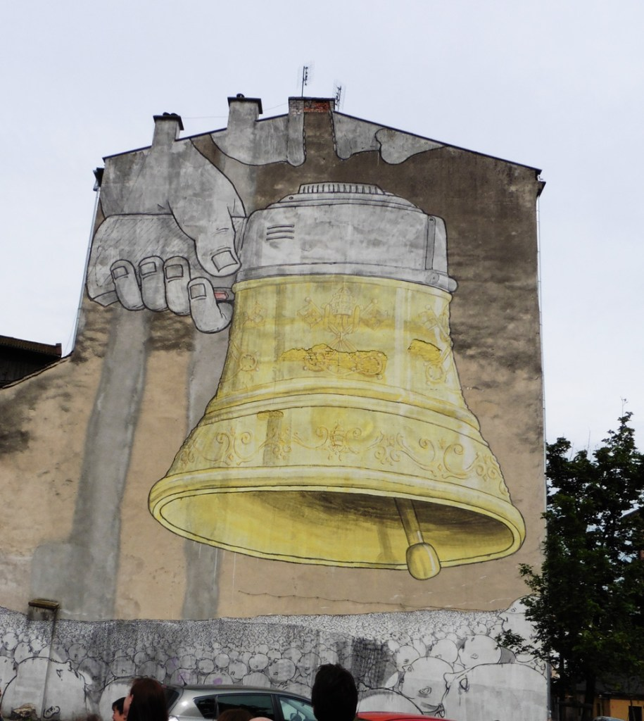 Street art showing a megaphone/bell over a crowd
