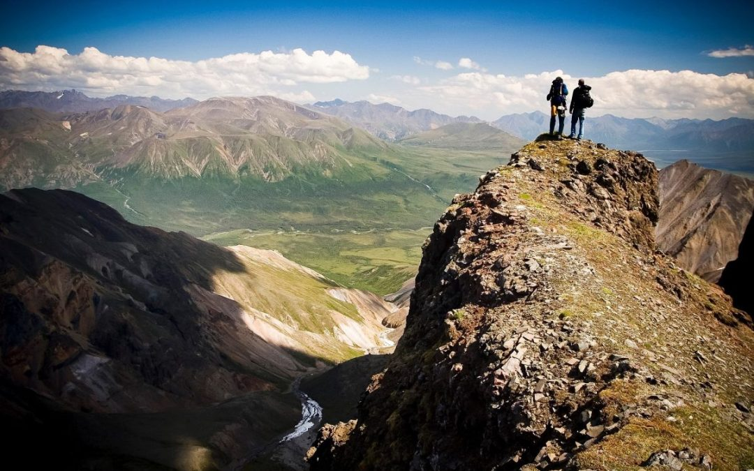 Hikers in Wrangell-St. Elias National Park, one of the least visited national parks in the United States