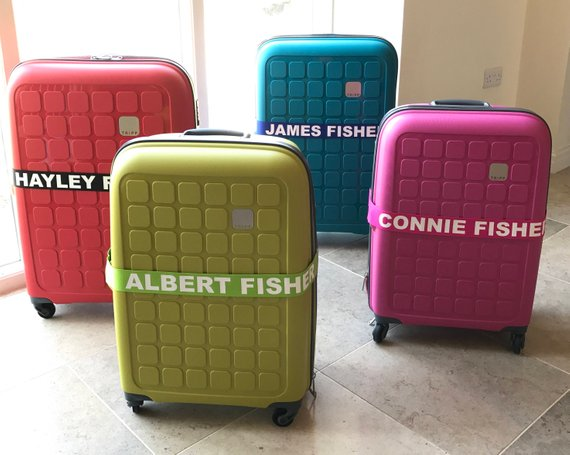 Brightly colored luggage with personalized luggage straps
