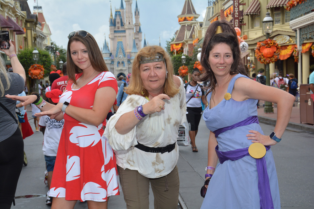Mickey's Not So Scary Costumes - women dressed as Lilo, a pirate, and Megara in the Magic Kingdom