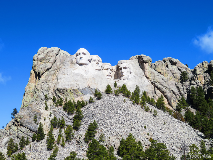 Photo of Mount Rushmore with four presidents carved into the stone