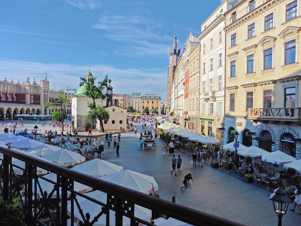 View of a European square with old buildings curving away