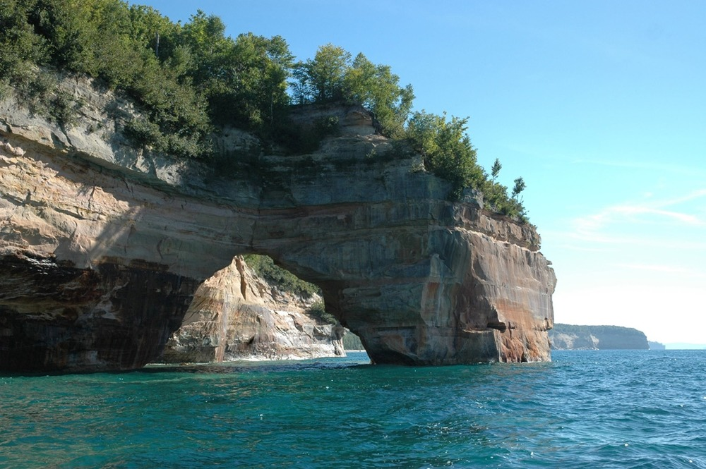 Cliffs and arch formations leading into a lake
