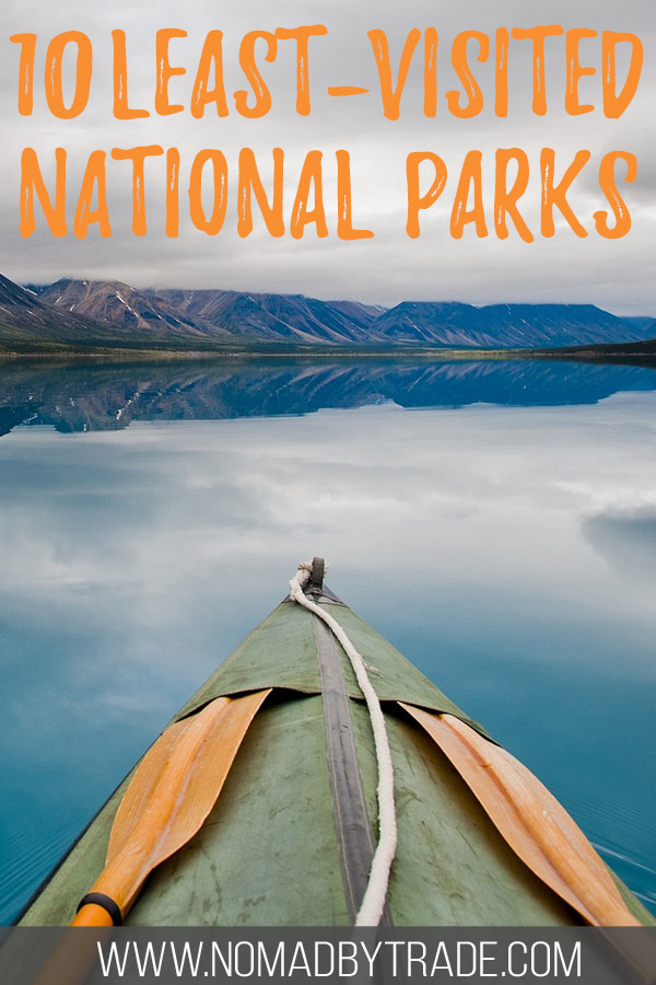 "Kayak in Lake Clark National Park with text overlay reading ""10 least-visited national parks"""