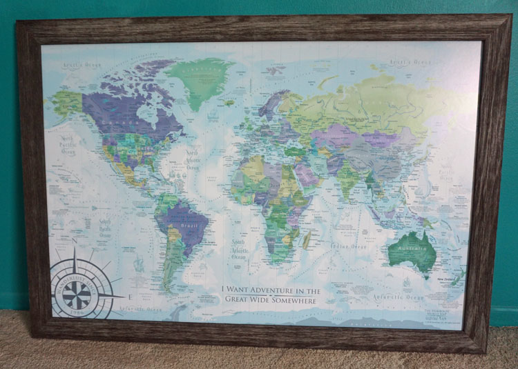 Purple, blue, and green framed pushpin world map