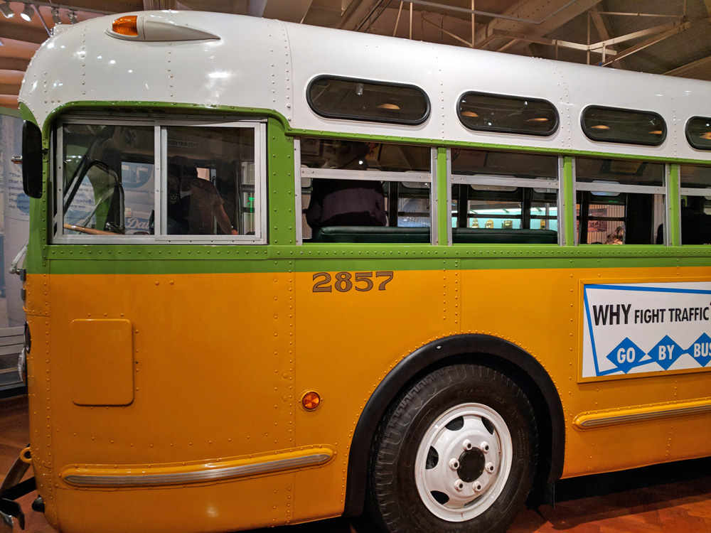 Vintage yellow, green, and white city bus