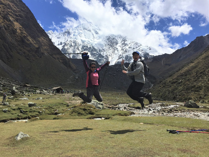 Hikers jumping along the Salkantay Trek trail in Peru
