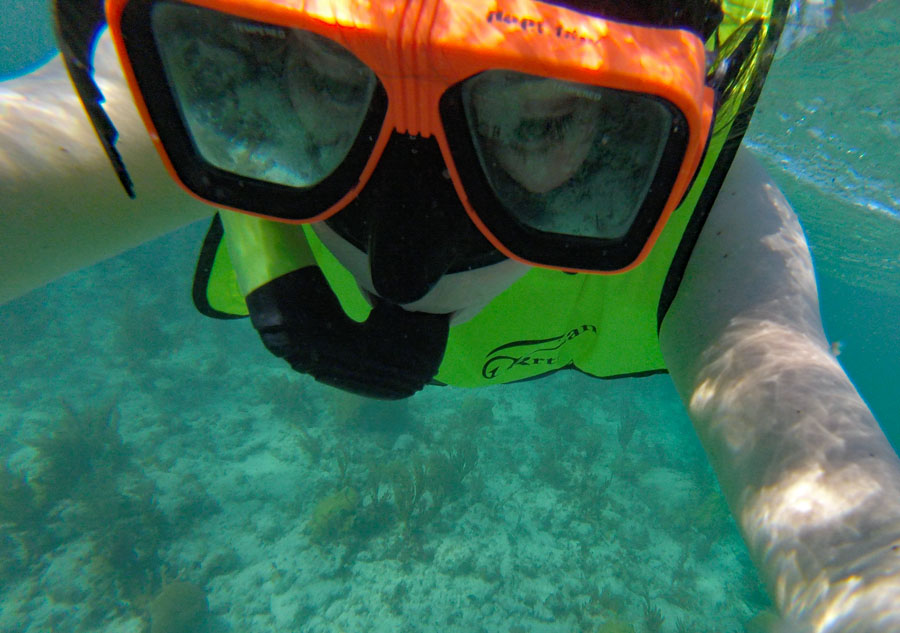 Woman swimming wearing a snorkel mask