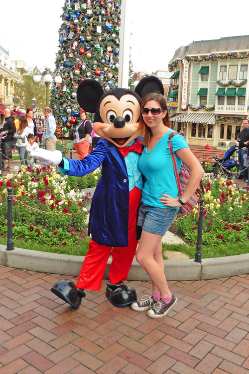 Woman posing with Mickey Mouse at Disneyland