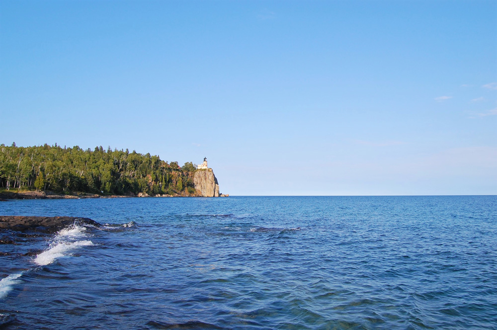Lighthouse on a cliff along the edge of Lake Superior