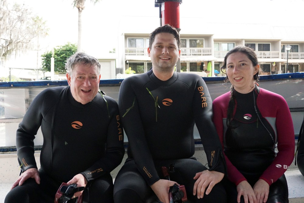 Swimmers in wetsuits on a boat in Crystal River, Florida