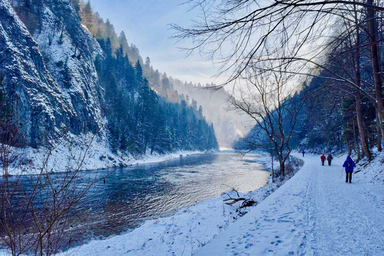 Snow-covered Tatra Mountains with a river running through a valley