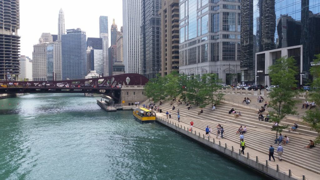Chicago Riverwalk with buildings on both sides - Travel Midwest