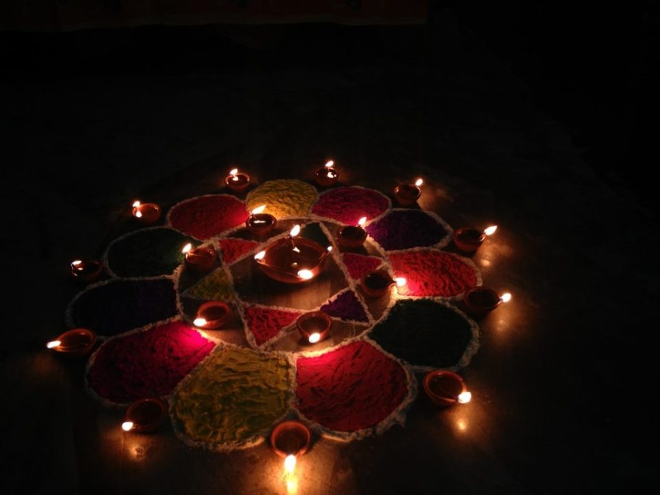 A Rangoli with Clay Lamps