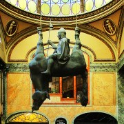 Prague's upside-down horse hangs with King Wenceslaus riding his belly.
