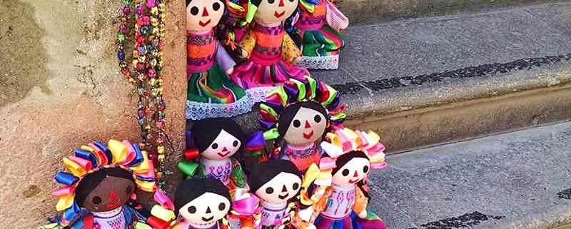 Mexican handicraft Otomi dolls for sale in a doorway in San Miguel de Allende, Mexico