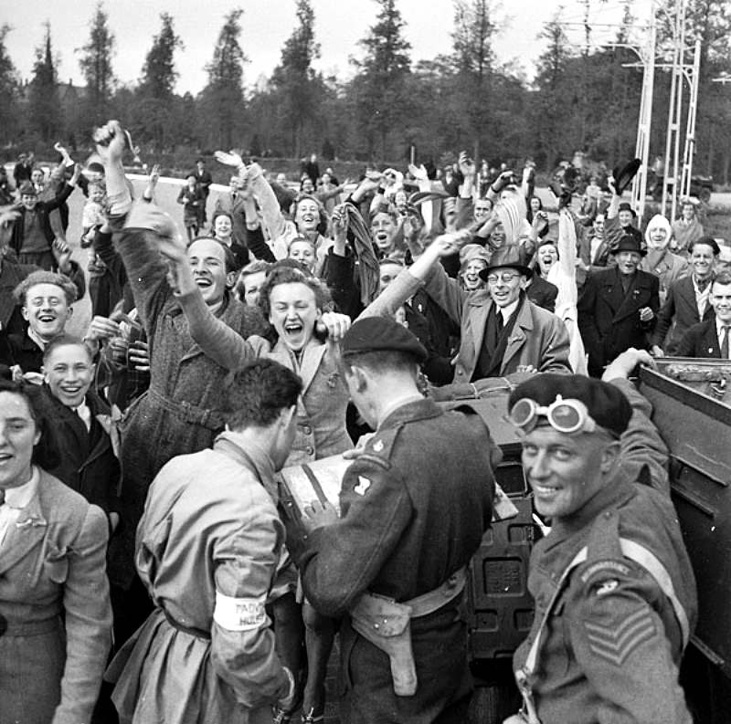 Dutch citizens celebrate as British soldiers with the 1st Canadian Army liberate the Netherlands in May, 1945.