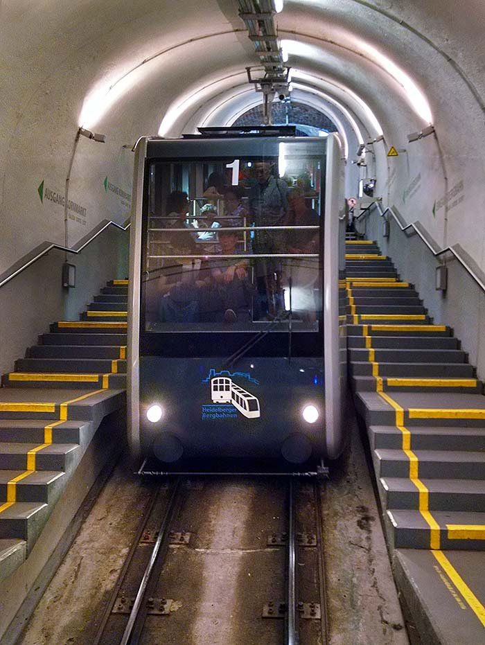 The downhill car of the Heidelberg Funicular--the Bergbahn--descends into the station at Kornmarkt.