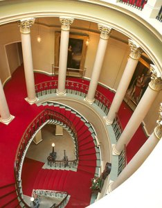 Robert Adam's grand sweep of oval, colonnaded staircase at Culzean leads to the Eisenhower Gallery.