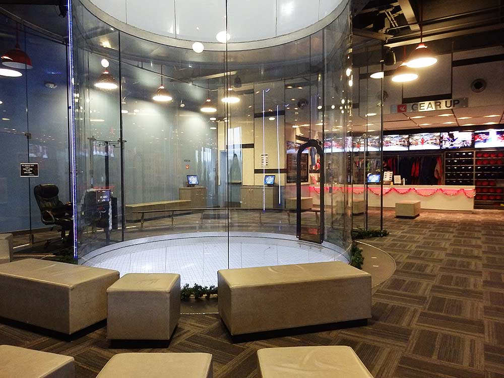 """The glass wind tunnel """"flight chamber"""" at iFly Portland. Those not flying can watch fro the padded seats."""