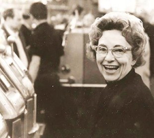 Vintage photo of my mom at a slot machine in the 1950s