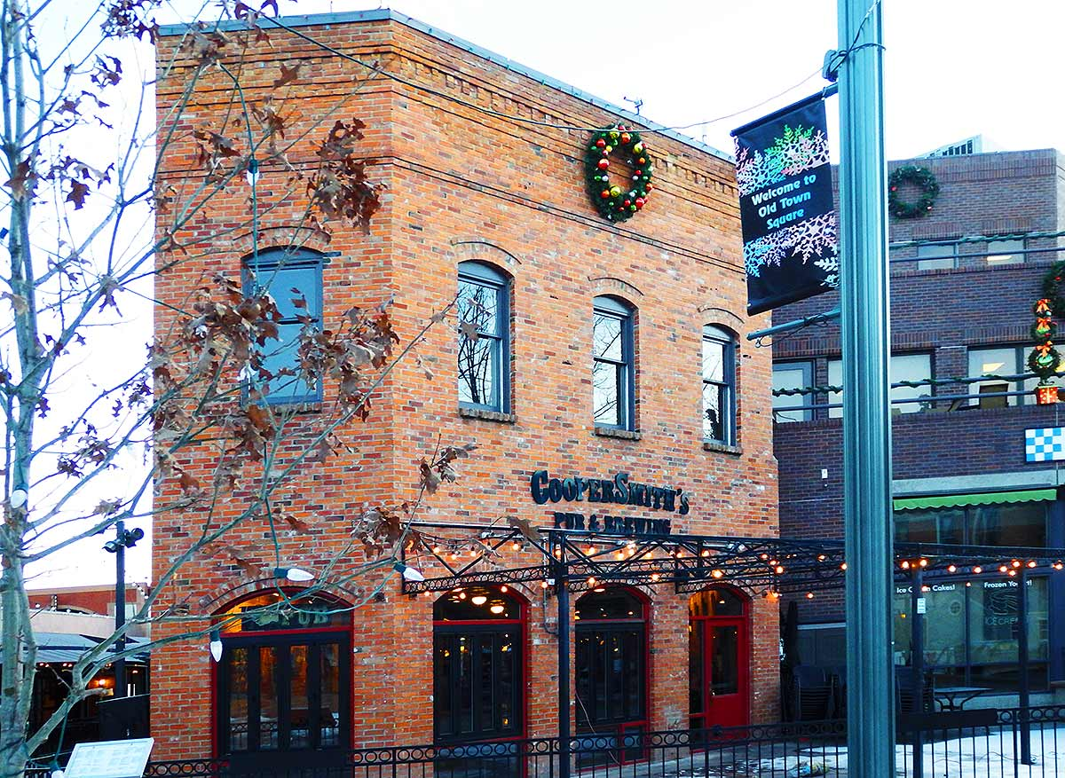 The redbrick building of Coopersmith's Pub & Brewery, right on Old Town Square, the happening heart of the neighborhood.