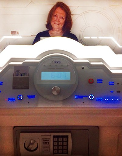 Cozy in my Izzzleep capsule, showing the control panel, safe, and large mirror.